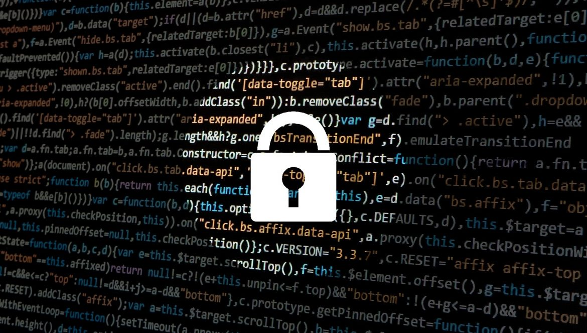 A software lock on top of several codes depicting the concept of cybersecurity