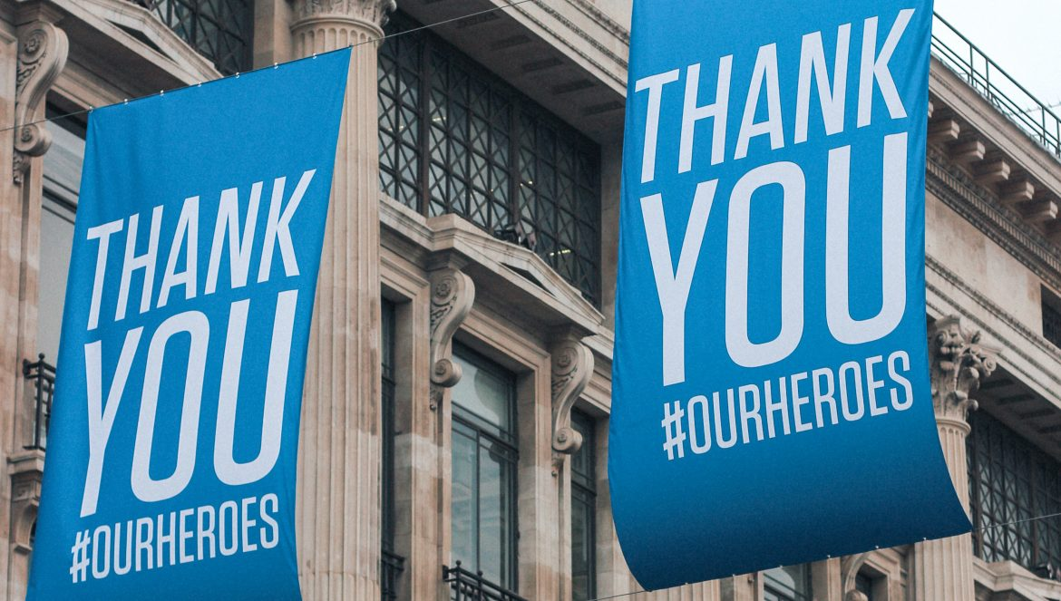 Banners with the words 'Thank You #OURHEROES' thanking key workers and NHS staff during the COVID-19 pandemic on Oxford Street, London